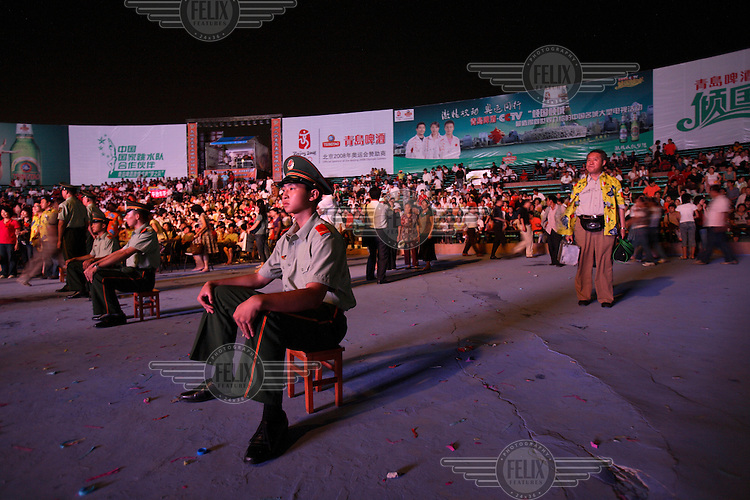 Chinese army soldiers sit in front of the crowd as a security measure during the Qingdao Beer Festival. Qingdao is an ex-German colony that celebrates their own version of the Oktoberfest.