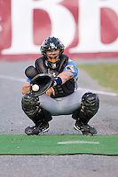 Catcher Tyler Flowers (12) of the Myrtle Beach Pelicans warms up the starting pitcher in the bullpen at Harry Grove Stadium in Frederick, MD, Monday July 14, 2008. (Photo by Brian Westerholt / Four Seam Images)