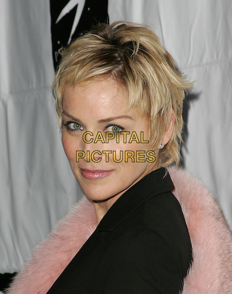SHARON STONE.Attends Project Angel Food's 11th Annual Angel Awards Gala held at Project Angel Food in West Hollywood, California,.August 21st 2004..portrait headshot pink fur stole wrap black suit.Ref: DVS.www.capitalpictures.com.sales@capitalpictures.com.©Capital Pictures.