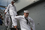 Teenage Sea Cadets from the Naval Operations Support Center in Marino Valley on the final voyage of the battleship USS Iowa from Berth 51 to its new home at Berth 87 in San Pedro, Los Angeles, CA where it opens as a museum ship in July 2012.