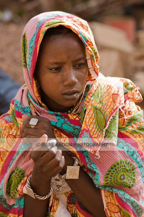 In Ouagadougou, Burkina Faso, Yuma Dicko, a young Fulani woman, prays the afternoon prayer.  More than half the population of this small, landlocked country is Muslim.