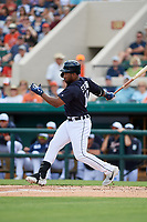 Detroit Tigers left fielder Christin Stewart (14) follows through on a swing during a Grapefruit League Spring Training game against the New York Yankees on February 27, 2019 at Publix Field at Joker Marchant Stadium in Lakeland, Florida.  Yankees defeated the Tigers 10-4 as the game was called after the sixth inning due to rain.  (Mike Janes/Four Seam Images)