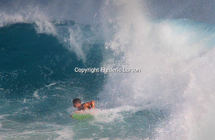 Sandy Beach in Hawaii during high-tide makes for huge breaking waves close to shore.
