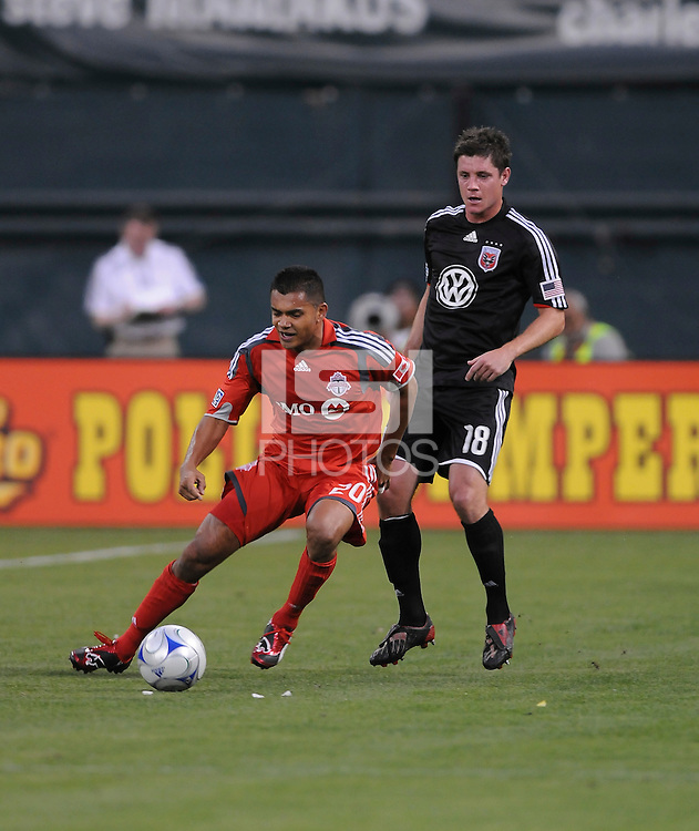Toronto FC. midfielder Amado Guevarra (20) shields the ball against DC United defender Devon McTavish (18).   DC United tied Toronto FC. 3-3 at  RFK Stadium, Saturday May 9, 2009.
