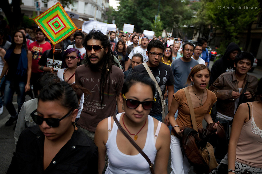 """2 July 2012 - Mexico City, Mexico - Thousands of demonstrators and university students who are members of the movement ?yo soy 132? (I am 132) march during a demonstration in Mexico City a day after the presidential election. The movement is protesting against The Federal Electoral Institute and against Mexican President-elect Enrique Pena Nieto, candidate of the Institutional Revolutionary Party (PRI), who claimed victory in the presidential election, after first official results showed him with 38 percent of the vote. Mexican leftist presidential candidate Andres Manuel Lopez Obrador said he would challenge the outcome of Sunday's election if results that he said were """"plagued by irregularities"""" were confirmed. Photo credit: Benedicte Desrus"""
