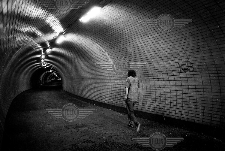 A man walks through the foot tunnel connecting the districts of Zizkov and Karlin.