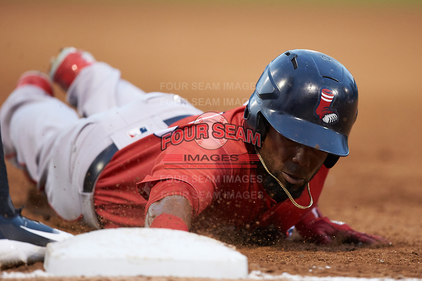 Aneury Tavarez (20) of the Pawtucket Red Sox dives back into first base during the game against the Charlotte Knights at BB&T BallPark on July 19, 2018 in Charlotte, North Carolina. The Knights defeated the Red Sox 4-3.  (Brian Westerholt/Four Seam Images)