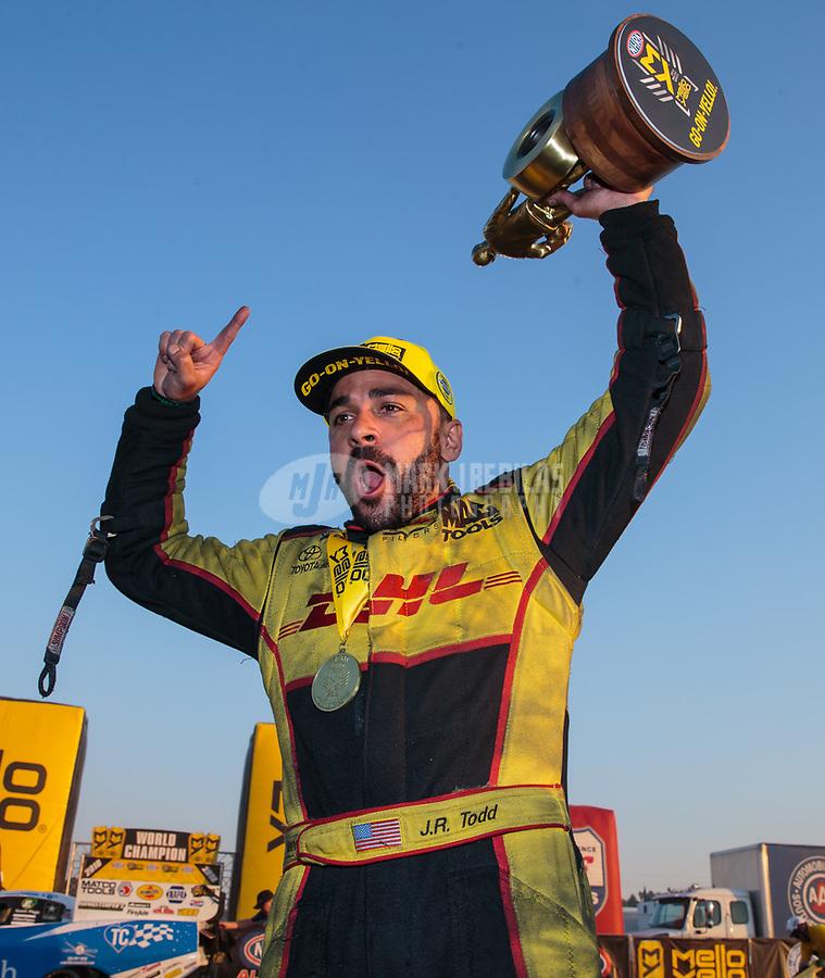 Nov 11, 2018; Pomona, CA, USA; NHRA funny car driver J.R. Todd celebrates after winning the Auto Club Finals at Auto Club Raceway. Mandatory Credit: Mark J. Rebilas-USA TODAY Sports