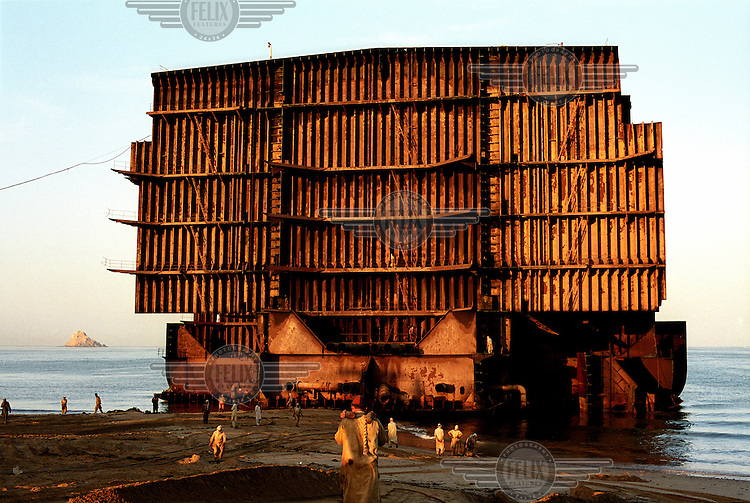 Small, cut-up segments of a ship are collected and stacked at the ship-breaking yard in Gaddani.