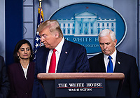United States President Donald J. Trump, center, US Vice President Mike Pence, right, and Seema Verma, Administrator, Centers for Medicare and Medicaid Services, left, leave after speaking on the COVID-19 (Coronavirus) pandemic during a Coronavirus Task Force briefing in the Brady Press Briefing Room at the White House in Washington, DC, March 18, 2020, in Washington, D.C. <br /> Credit: Kevin Dietsch / Pool via CNP/AdMedia
