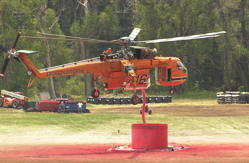 A wildland firefighting helicopter refills its water tank with slurry fire retardant solution while fighting the Missionary Ridge Fire north of Durango, Colorado in June 2002.