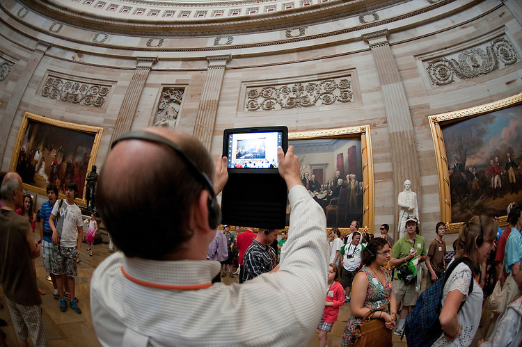 UNITED STATES - JUNE 29: A tourist takes photos of the Capitol Rotunda using his tablet computer on Wednesday, June 29, 2011. (Photo By Bill Clark/Roll Call)