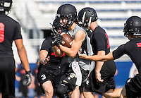 NWA Democrat-Gazette/JASON IVESTER --07/10/2015--<br /> Bentonville junior Hadley Gregg (center) tries to break through Westmoore defenders during the Southwest Elite 7-on-7 Tournament on Friday, July 10, 2015, at Rogers High School.