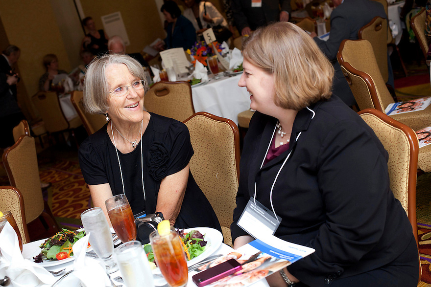 Silver honoree Margi Miller, left, and Stacy Groff, right, talk at the Older Volunteers Enrich America Awards at the Double Tree Hotel in Washington, DC on Friday, June 17, 2011.