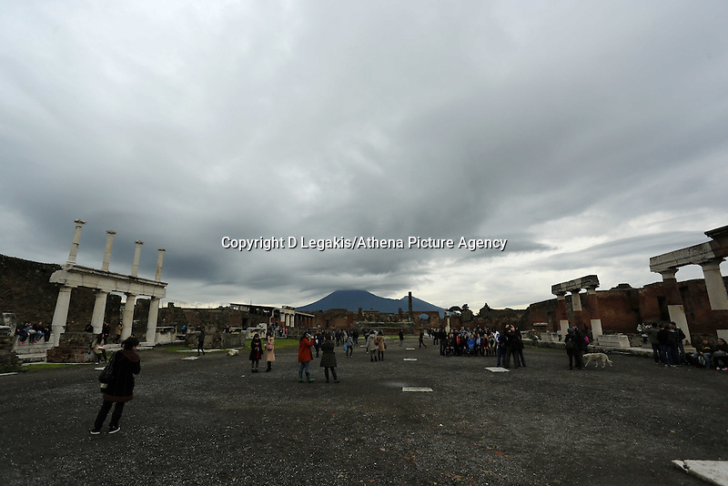 Pictured: A thick dark cloud forming over  Mount Vesuvius as seen from the ruins in Pompeii, southern Italy. Thursday 27 February 2014