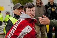 Saturday 05 April 2014<br /> Pictured: A white pride supporter looks angrily as he is taken back inside the police cordon after trying to attack anti fascist protesters <br /> Re: White Pride and Anti Fascist groups protest in Swansea City Cebtre