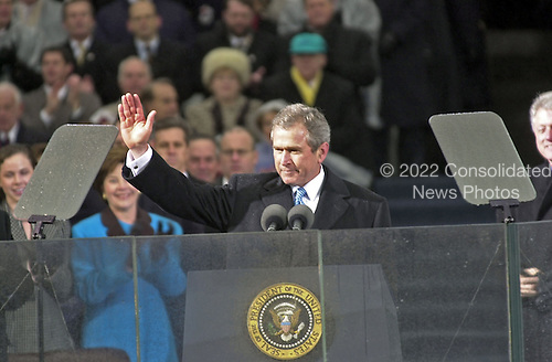 United States President George W. Bush waves to the crowd at his Inaugural ceremony at The U.S. Capitol in Washington, D.C. on January 20, 2001..Credit: David N. Berkowitz for Newsweek - Pool via CNP.