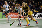 Berlin, Germany, January 31: Annelotte Ziehm #23 of Harvestehuder THC in action against Hanna Valentin #18 of HTC Uhlenhorst Muehlheim During the 1. Bundesliga Damen Hallensaison 2014/15 semi-final hockey match between HTC Uhlenhorst Muehlheim (white/green) and Harvestehuder THC (black/yellow) on January 31, 2015 at the Final Four tournament at Max-Schmeling-Halle in Berlin, Germany. Final score 6-5 after penalties (3-1, 3-3, 3-3, 3-3). (Photo by Dirk Markgraf / www.265-images.com) *** Local caption ***