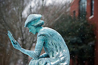 Snow Day on campus - Library scholar sculpture.<br />  (photo by Megan Bean / &copy; Mississippi State University)