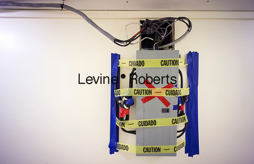 A temporary electrical distribution panel with its wiring is seen in an apartment building hallway in New York during an asbestos abatement project on Saturday, November 16, 2013. (© Richard B. Levine)