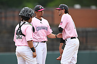 Hickory Crawdads catcher Melvin Novoa (32), pitching coach Jose Jaimes and pitcher Tim Brennan (15) talk things over on the mound during the game with the Charleston Riverdogs at L.P. Frans Stadium on May 12, 2019 in Hickory, North Carolina.  The Riverdogs defeated the Crawdads 13-5. (Tracy Proffitt/Four Seam Images)