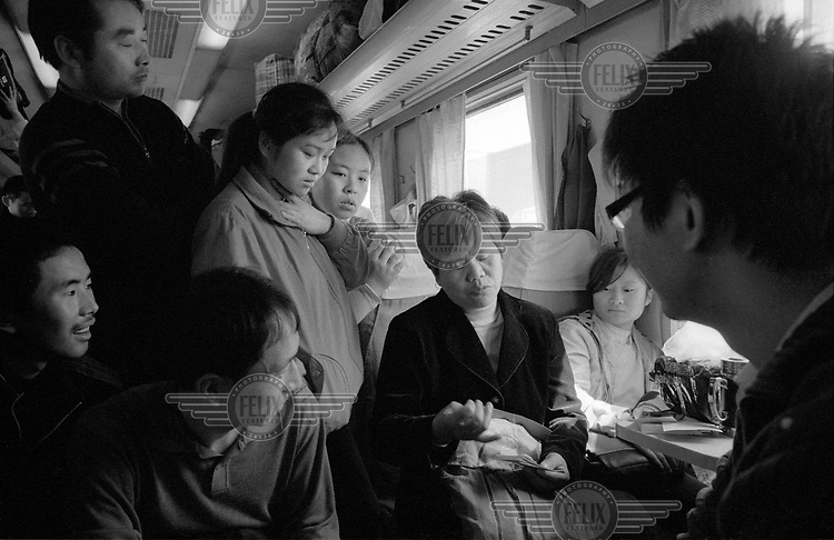 Migrants on their way to Beijing. This woman was on her way to Beijing to make an appeal to central government officials with a delegation of villagers who had seen their farmland forcefully expropriated by local party cadres who had sold the land in the Pearl River Delta to property developers. ...