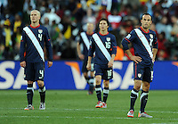 USA players look dejected following Slovenia's second goal