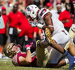 Florida State tight end Ryan Izzo is taunted by Louisville safety Connor Kronk after a tackle in the first half of an NCAA college football game in Tallahassee, Fla., Saturday, Oct. 17, 2015. Florida State defeated Louisville 41-21. (AP Photo/Mark Wallheiser)