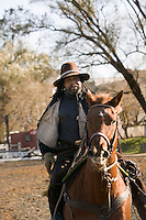 2 December 2006 - New York City, NY - Lenard Hebert, a member of the Federation of Black Cowboys, rides his horse at the Cedar Lanes stables in the borough of Queens in New York City, USA, 2 December 2006. The Federation gathers black men and women who recreate the heritage of black cowboys, teach kids to ride and put on 'rodeo showdeos'.