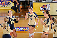 17 November 2011:  FIU's team (pictured, Chanel Araujo (13), Jovana Bjelica (16), Andrea Lakovic (1)) celebrate winning a point in the third set as the FIU Golden Panthers defeated the Denver University Pioneers, 3-1 (25-21, 23-25, 25-21, 25-18), in the first round of the Sun Belt Conference Tournament at U.S Century Bank Arena in Miami, Florida.
