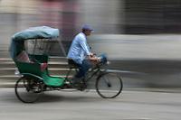 Suzhou, Jiangsu, China.  Pedicabs Transport Visitors through Tongli Ancient Town near Suzhou.