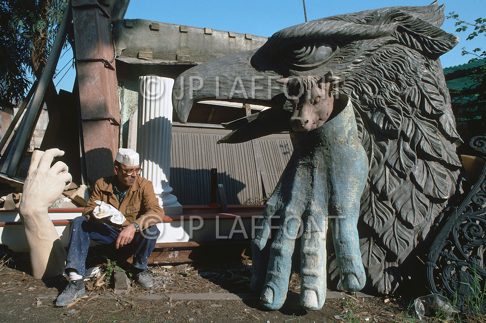 "April 27, 1990, Rome, Italy. Photographing for the book ""One day in the life of Italy"", an exploration of Rome. In Cinecitta, at the D'Angelis Sculpture warehouse, props such as the bust of Mussolini are stored."