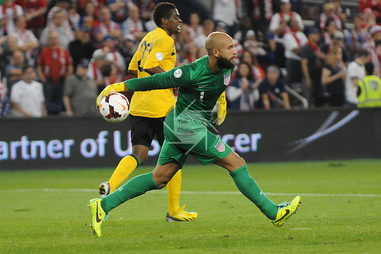 Team USA defeated Jamaica 2-0 in a World Cup qualifying game at Sporting Park in Kansas City, Kansas, USA on Friday October 11, 2013.  The USA team is already guaranteed a spot in the World Cup due to their record going into this game. USA goalkeeper Tim Howard (1) rolls out the ball after saving a shot on goal in the second half.  Behind him is Jamaica forward Deshorn Brown (22).