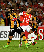 BOGOTA - COLOMBIA – 23 – 05 - 2017: Anderson Plata (Der.) jugador de Independiente Santa Fe, disputa el balón con Marvin Bejarano (Izq.) jugador de The Strongest, durante partido entre Independiente Santa Fe de Colombia y The Strongest de Bolivia, de la fase de grupos, grupo 2, fecha 6 por la Copa Conmebol Libertadores Bridgestone 2017, en el estadio Nemesio Camacho El Campin, de la ciudad de Bogota. / Anderson Plata (R) player of Independiente Santa Fe, fights for the ball with Marvin Bejarano (L) player of The Strongest during a match between Independiente Santa Fe of Colombia and The Strongest of Bolivia, of the group stage, group 2 of the date 6th, for the Conmebol Copa Libertadores Bridgestone 2017 at the Nemesio Camacho El Campin in Bogota city. VizzorImage / Luis Ramirez / Staff.