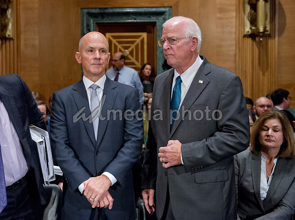 "Richard F. Smith, former Chairman and Chief Executive Officer, Equifax, Inc., left, and his advisor former United States Senator Saxby Chambliss (Republican of Georgia), right, prior to giving testimony before the US Senate Committee on Banking, Housing, and Urban Affairs as they conduct a hearing entitled, ""An Examination of the Equifax Cybersecurity Breach"" on Capitol Hill in Washington, DC on Tuesday, October 3, 2017. Photo Credit: Ron Sachs/CNP/AdMedia"
