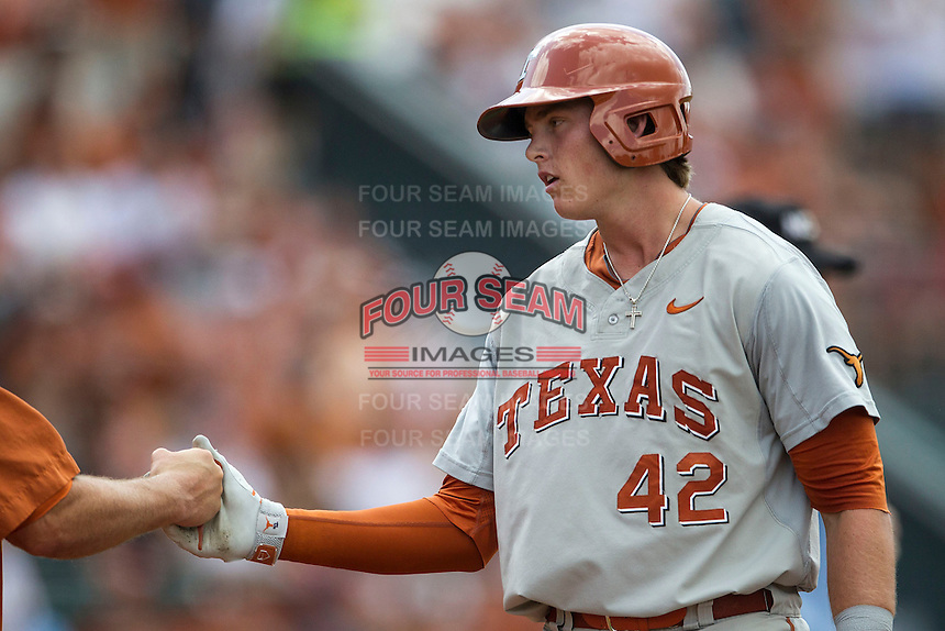 Texas Longhorns first baseman Kacy Clemens (42) at first base after getting a hit in the NCAA baseball game against the Houston Cougars on June 6, 2014 at UFCU Disch–Falk Field in Austin, Texas. The Longhorns defeated the Cougars 4-2 in Game 1 of the NCAA Super Regional. (Andrew Woolley/Four Seam Images)