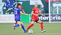 Portland, OR - Saturday July 30, 2016: Kendall Fletcher, Dagny Brynjarsdottir during a regular season National Women's Soccer League (NWSL) match between the Portland Thorns FC and Seattle Reign FC at Providence Park.