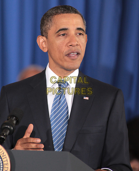 U.S. President Barack Obama speaks at Yeadon Regional Head Start Center in Yeadon, Pennsylvania, USA..November 8th,  2011.half length black suit jacket podium speech blue tie headshot portrait .CAP/RKE/EML.©EML/RockinExposures/Capital Pictures.