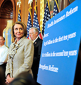 United States House Speaker Nancy Pelosi (Democrat of California) looks at a chart of benefits for health insurance reform as she and U.S. House Democratic Leaders meet reporters to announce the savings to the federal budget by their health care reform effort in the U.S. Capitol in Washington, D.C. on Thursday, March 18, 2010..Credit: Ron Sachs / CNP