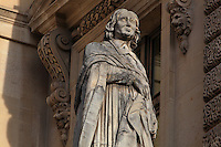 Statue of Jacques-Benigne Bossuet, 1627-1704, bishop, theologian and writer, by Louis Desprez, at the Colbert Wing, in the Cour Napoleon at the Musee du Louvre, Paris, France. A series of 86 statues of famous men were placed in this courtyard 1853-57 under the architects Louis Visconti and Hector Lefuel. Picture by Manuel Cohen