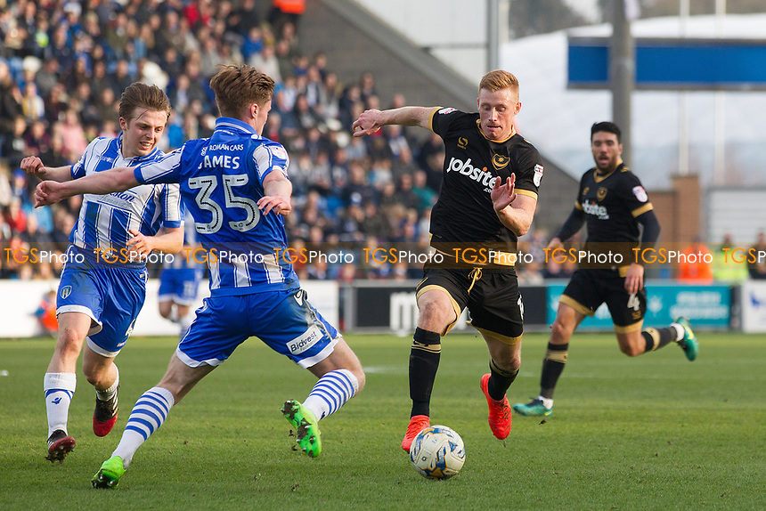 Cameron James of Colchester United attempts to thwart Eoin Doyle of Portsmouth run at goal during Colchester United vs Portsmouth, Sky Bet EFL League 2 Football at the Weston Homes Community Stadium on 11th March 2017