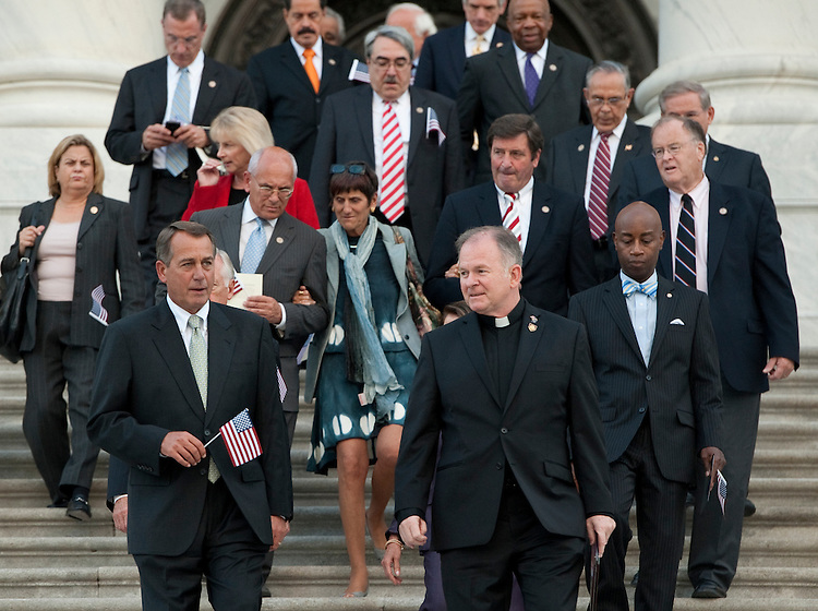 UNITED STATES - SEPTEMBER 12: Speaker of the House John Boehner, R-Ohio, left, and Reverend Patrick J. Conroy,.Chaplain of the U.S. House of Representatives, members of both houses of Congress down the East Front steps of the Capitol to hold a 9/11 Remembrance Ceremony on Monday, Sept. 12, 2011. (Photo By Bill Clark/Roll Call)