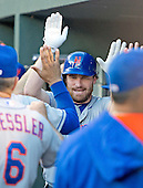 New York Mets second baseman Daniel Murphy (28) is congratulated by his teammates in the dugout after connecting for a first inning home run against the Baltimore Orioles at Oriole Park at Camden Yards in Baltimore, Maryland on Wednesday, August 19, 2015.  The Orioles won the game 5 - 4.<br /> Credit: Ron Sachs / CNP<br /> (RESTRICTION: NO New York or New Jersey Newspapers or newspapers within a 75 mile radius of New York City)