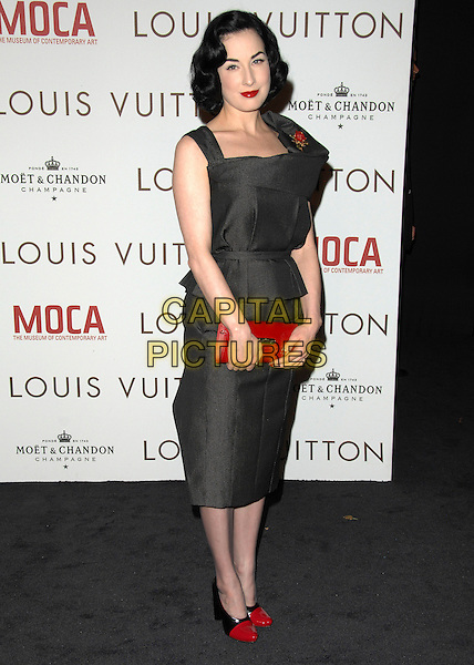 DITA VON TEESE.at The Louis Vuitton Gala Celebrating Murakami Exhibition held at  The Geffen Contemporary at MOCA in Los Angeles, California, USA, October 28 2007.                                           full length red clutch bag shoes twon tone  toe cap black top skirt dress ruched  brooch flower.CAP/DVS.©Debbie VanStory/Capital Pictures