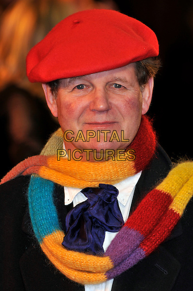 Michael Morpurgo, 'War Horse' author .UK Premiere of 'War Horse' at the Odeon, Leicester Square, London, England..January 8th 2012.portrait headshot coat black red flat cap hat striped scarf blue purple yellow writer creator .CAP/PL.©Phil Loftus/Capital Pictures.