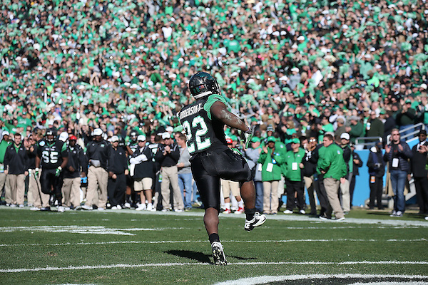 DENTON, TX  JANUARY 1: Antoinne Jimmerson #22 of the North Texas Mean Green celebrates after scoring a touch down against the UNLV Rebels during the Heart of Dallas Bowl at Cotton Bowl Stadium in Dallas on January 1, 2014 in Dallas, TX.  Photo by Rick Yeatts North Texas won 36-14 over UNLV.