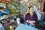 "Gita Giri stands in her shop in Adamtar, a village in the Dhading District of Nepal. Dan Church Aid, a member of the ACT Alliance, has provided food, shelter, livelihood, winterization assistance and a variety of other support to indigenous villagers here in the wake of a devastating 2015 earthquake. Giri was chosen by her neighbors to sell warm clothes, blankets and shelter materials which they could purchase with cash vouchers provided by the ACT Alliance. Giri made no profit on the sales. ""With people from around the world assisting our community, how could I make a profit on those supplies?"" she asked."