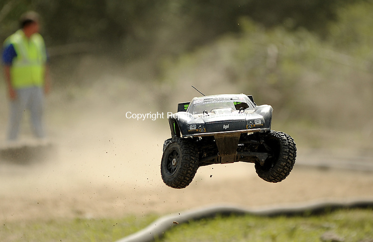 WINSTED, CT-09 JUNE 2012--060012JS07--A fifth scale vehicle makes a jump from a ramp on the off-road course during the Northeast Fifth-Scale Championships Saturday hosted by RC Hobbies and More in Winsted. .Jim Shannon Republican-American