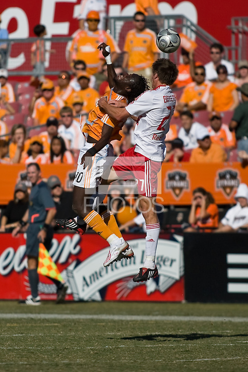 Houston Dynamo forward Kei Kamara (10) and New York Red Bulls defender Andrew Boyens (27) go up for the header.  New York Red Bulls defeated Houston Dynamo 3-0 for an aggregate  score of 4-1 over Houston Dynamo   at Robertson Stadium in Houston, TX on November 9, 2008 in the second leg of the Western Conference semifinals.  Photo by Wendy Larsen/isiphotos.com