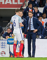 England Caretaker Manager (Head Coach) Gareth Southgate talks to John Stones (Man City) of England during a break in play during the International Friendly match between England and Spain at Wembley Stadium, London, England on 15 November 2016. Photo by Andy Rowland.